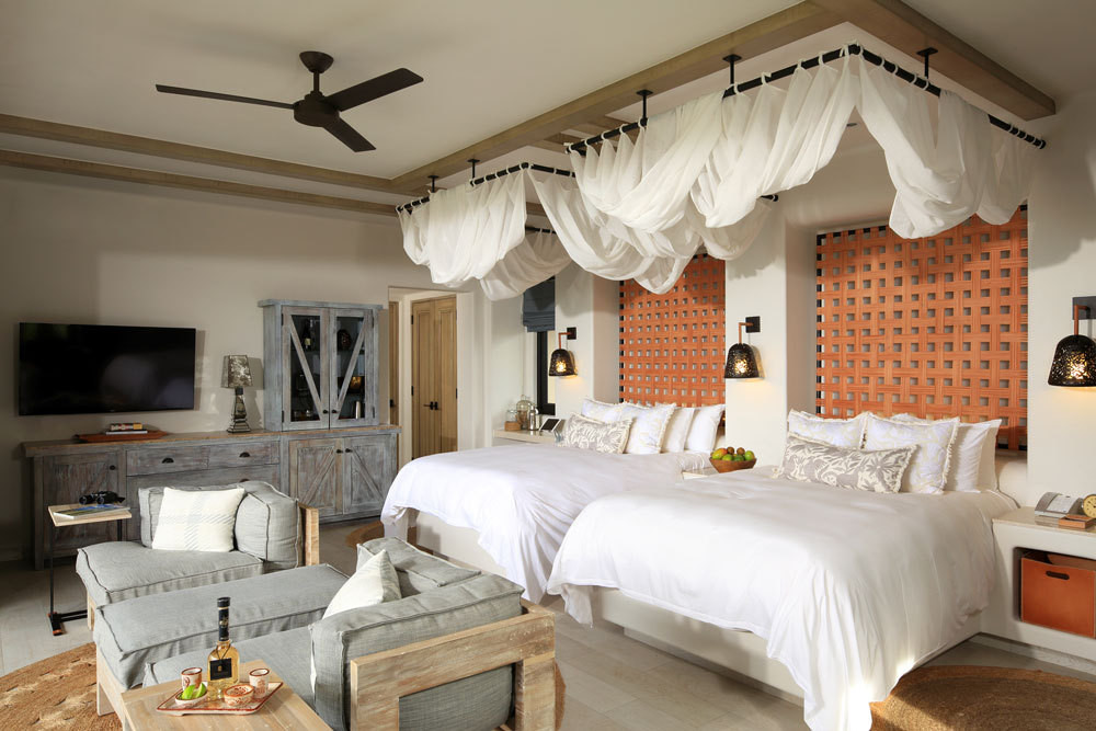 Woven leather headboards serve as focal points in guestrooms.