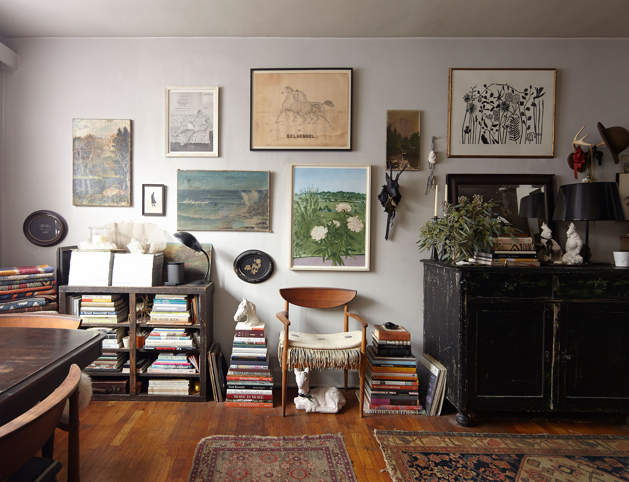 The main living area of Ann Stephenson and Lori Scacco's East Village studio, filled with meaningful art, books, textiles, and objects.