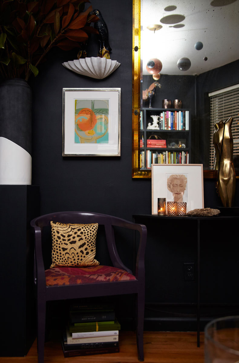 The dark walls of Masters downtown NYC pad create a cozy environment perfect for an intimate dinner party.