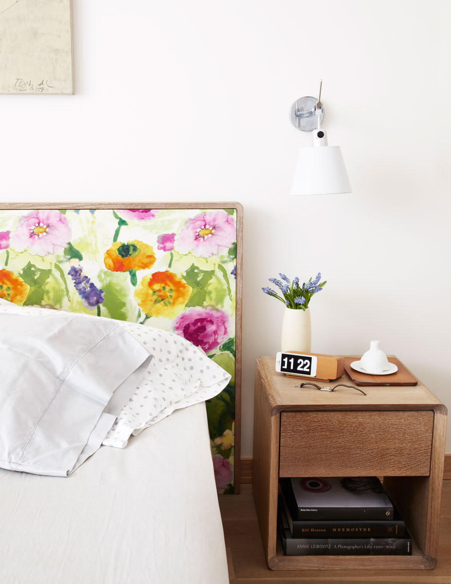 A watercolor floral adds a dose of color to the serene master bedroom.