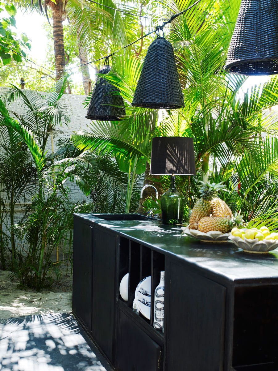 The outdoor kitchen and dining area of Doligé's compound.