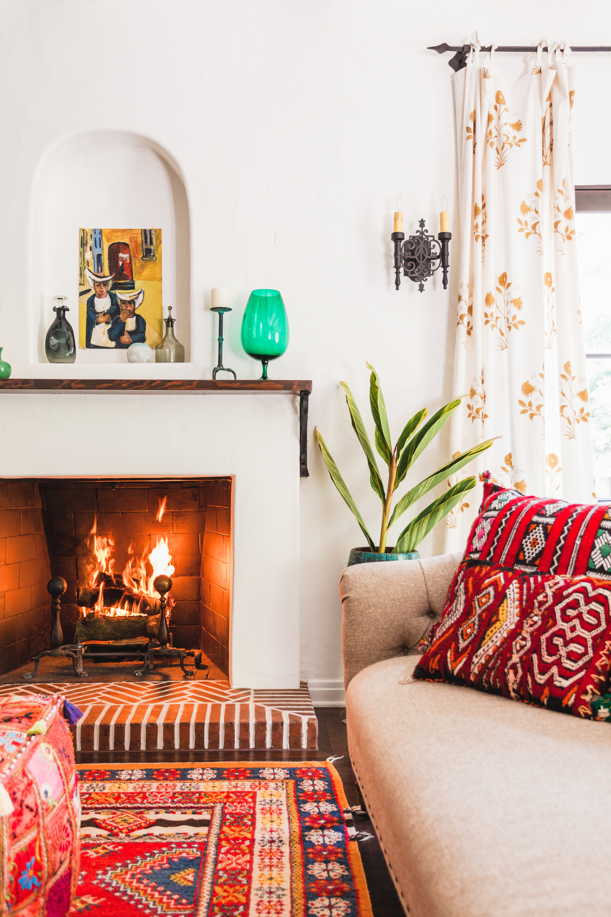 A coloful vignette near the fireplace is vivid and inviting. Oriana Koren for Lonny.