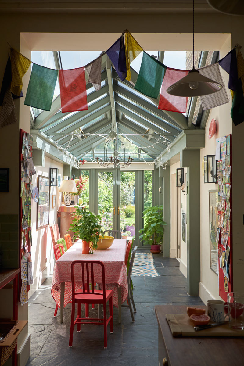 Prayer flags and pin boards mark the entrance to the atrium.