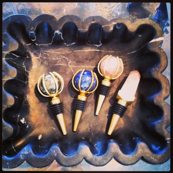 Wearstler's wine stoppers (fashioned from raw yet refined materials such as rose quartz) double as objets d'art.