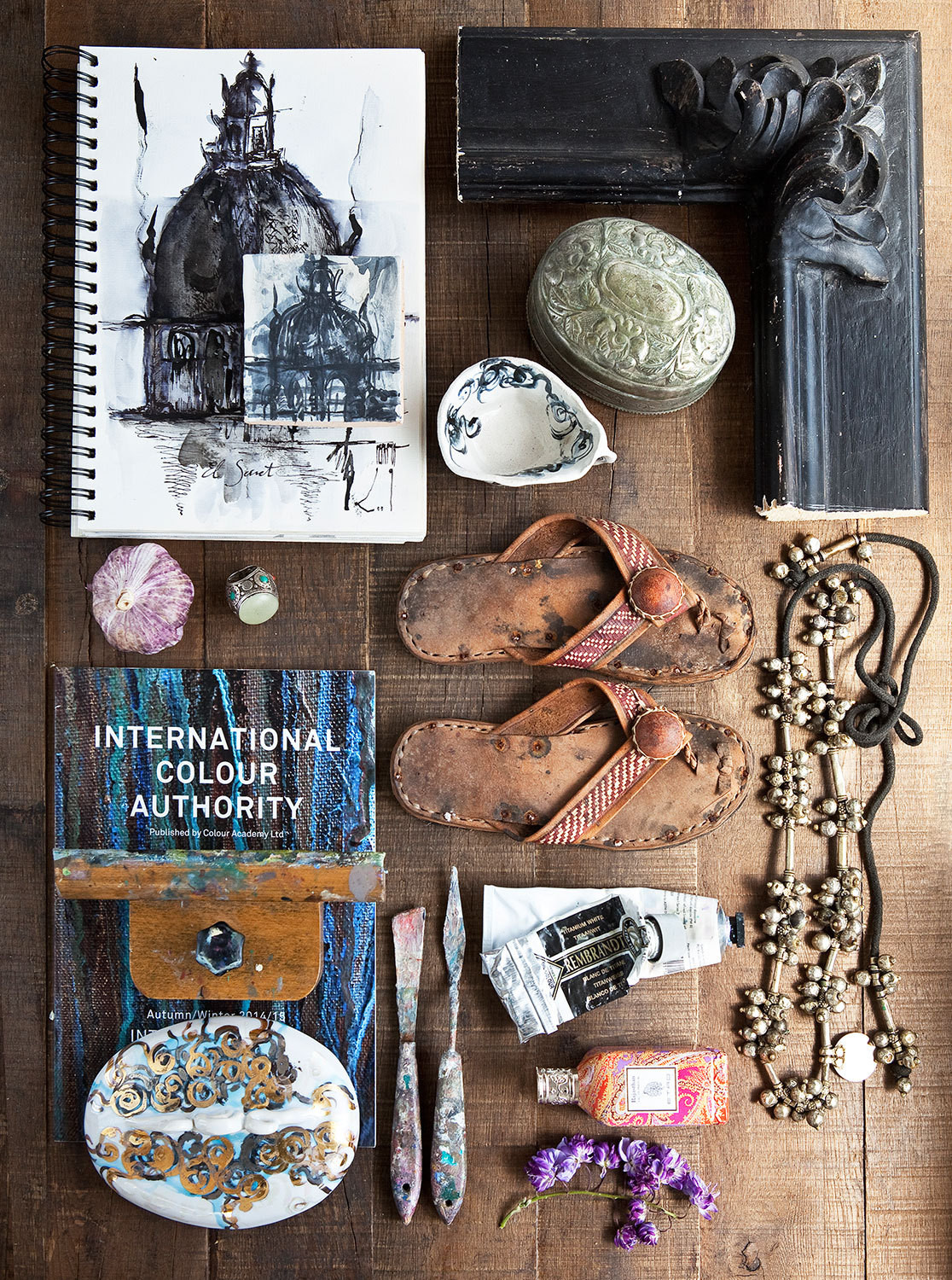 Small treasures picked up on Poch's extensive travels mingle with painted porcelain pieces, art supplies, and sketches.