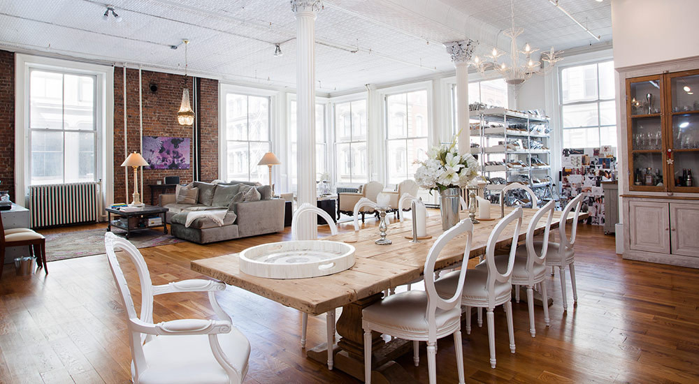 The light-filled loft space on Greene Street is minimally decorated with vintage and modern furniture finds, amidst a backdrop of exposed architectural elements.