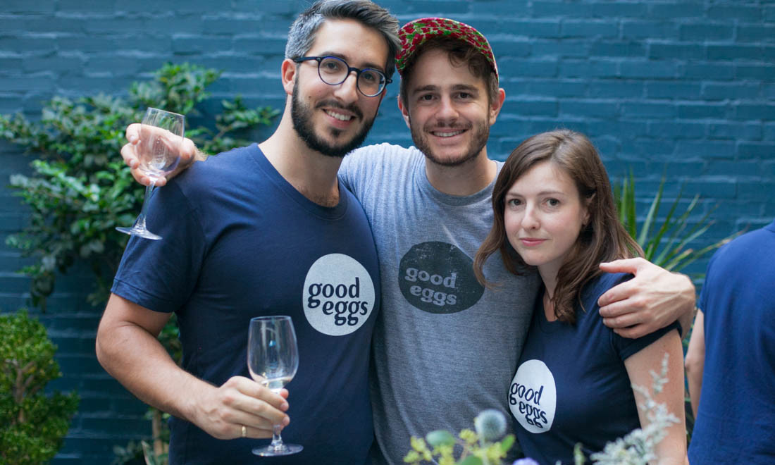 Julian Nachtigal, Max Kanter and Dani Fisher toast the pop-up market.