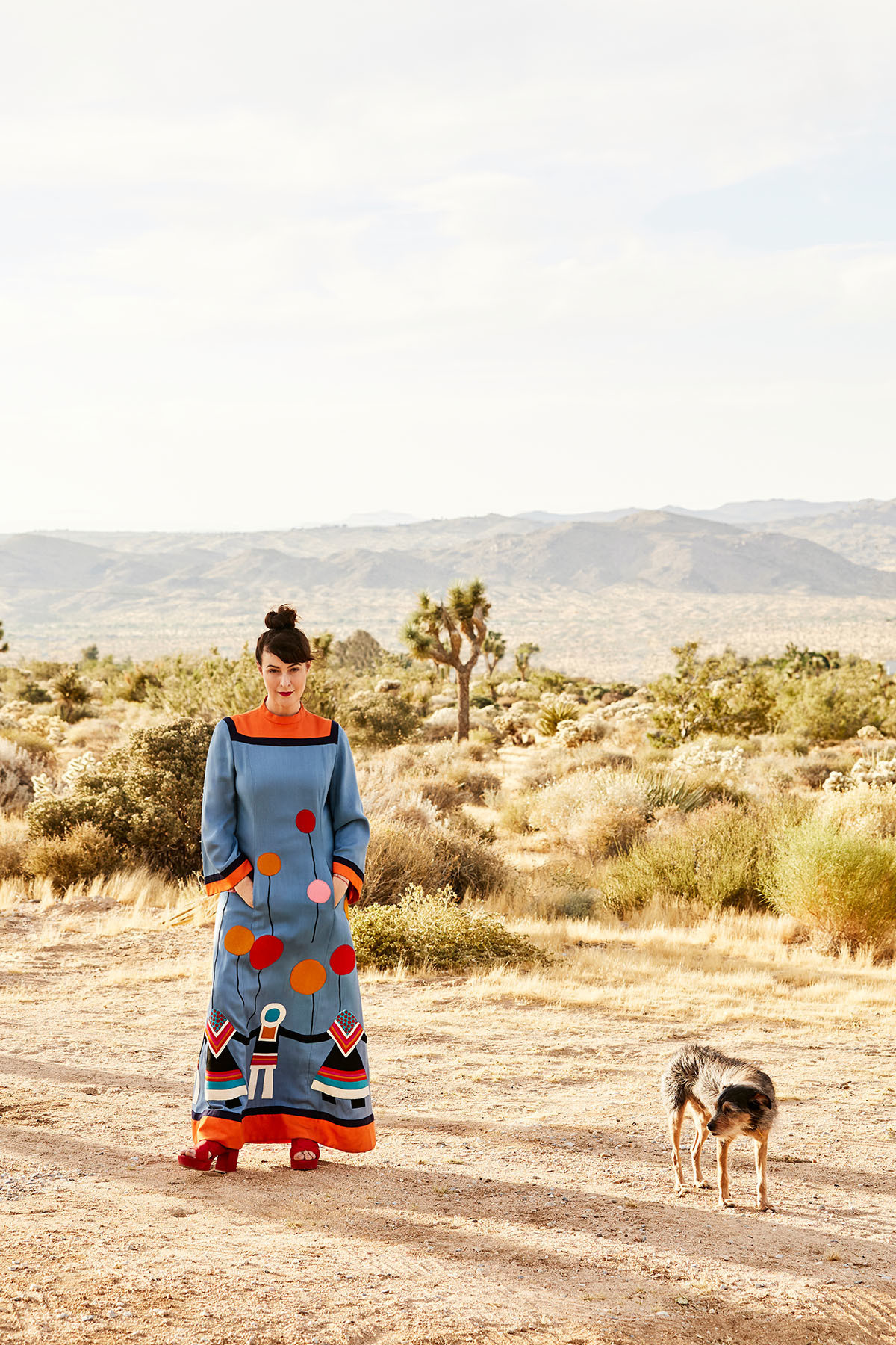 """Seeing the desert for the first time completely blew my mind, I just fell in love,"" says Calter, pictured here wearing a vintage dress from M Designer Vintage and More in Palm Springs."