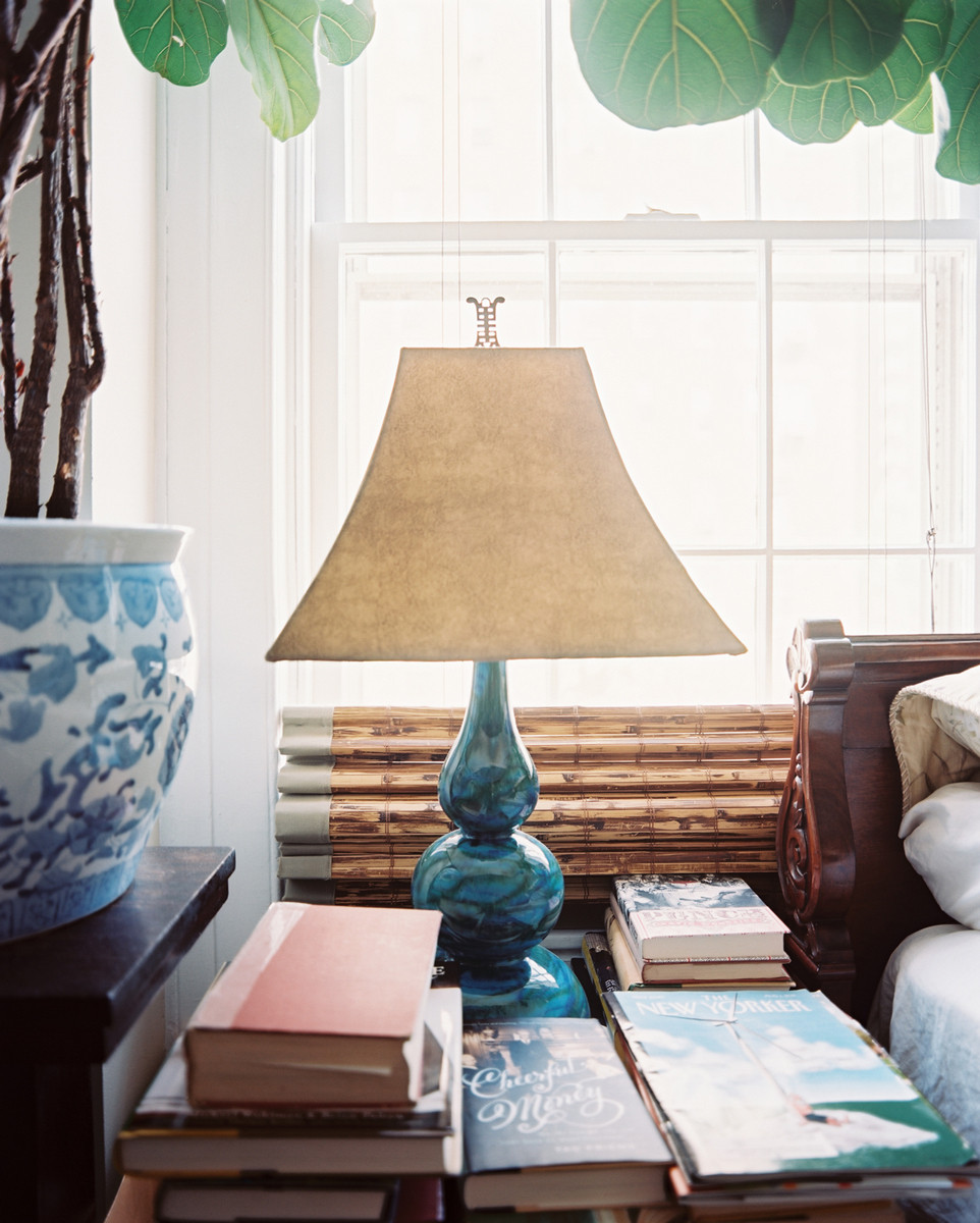Mementos and books give the master bedroom a collected look.