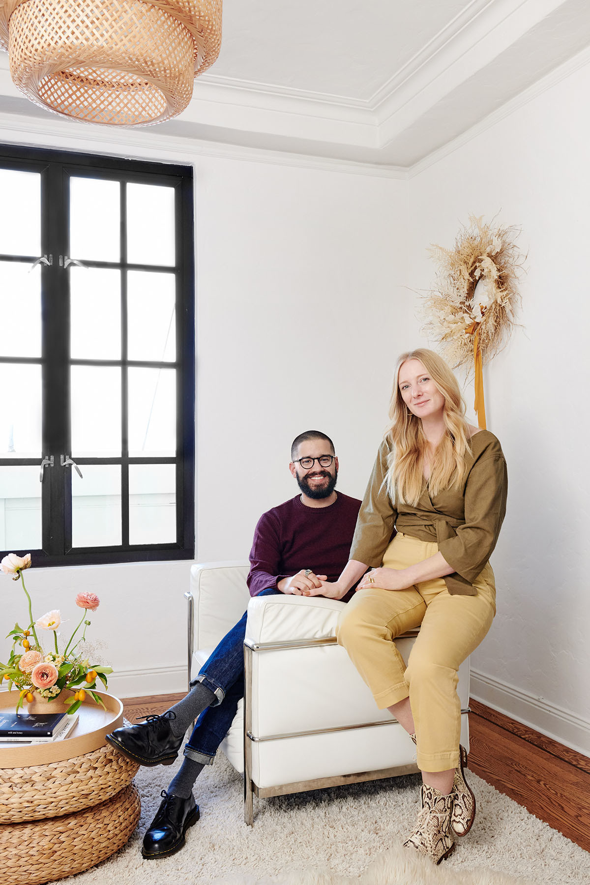 """Having a space that feels like a personal oasis is really important to me,"" notes Winter, pictured here with partner Andrés Barraza. ""Investing time, energy, and money into my apartment as a renter was definitely scary at first, but after every project or purchase there was never any regret."" Benjamin Moore Paint 