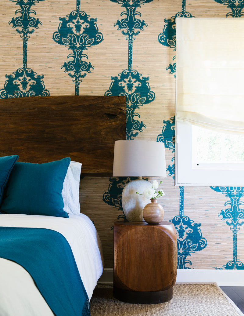 The guest bedroom balances earthy shades with a complementary jewel-tone teal.