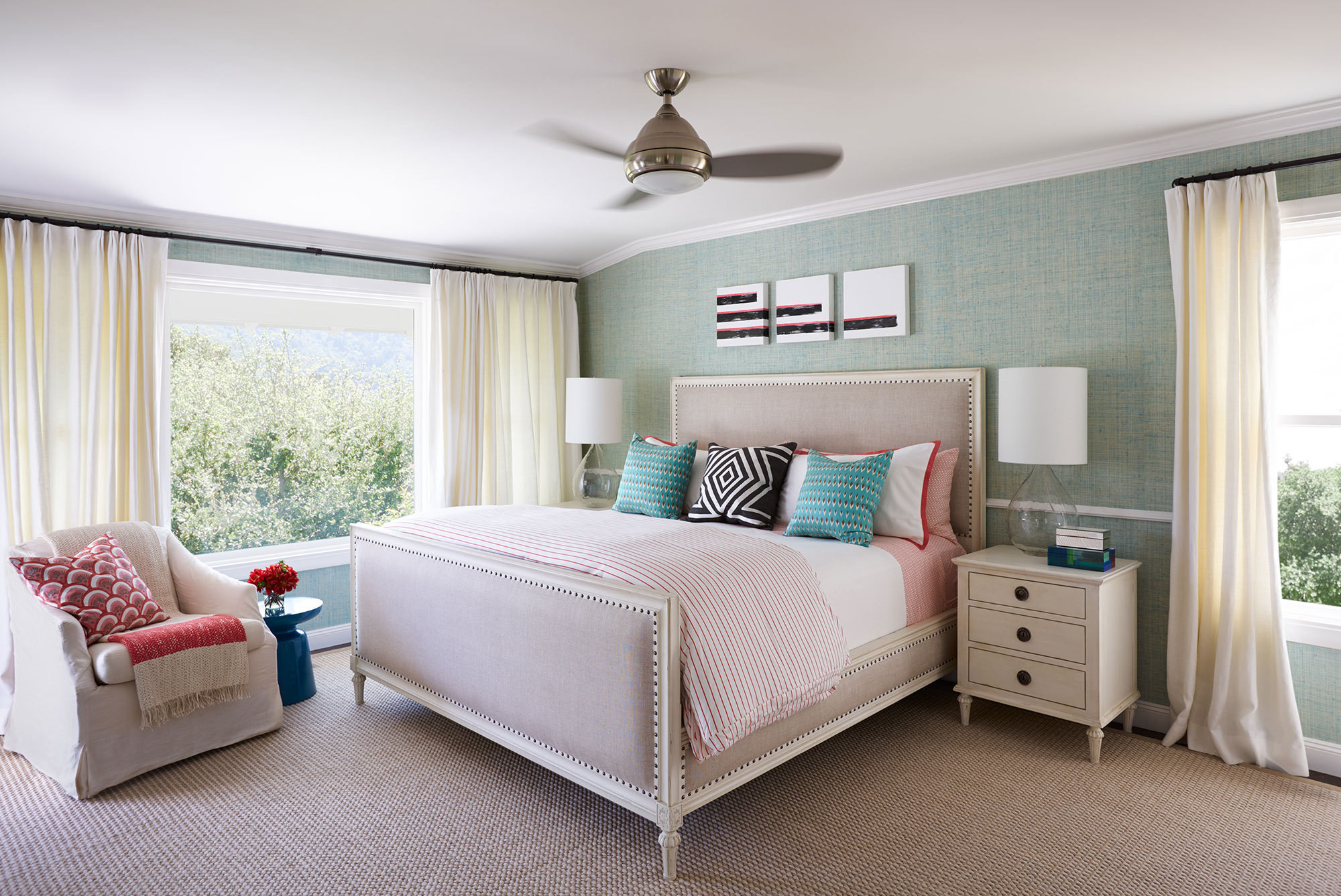 The master bedroom is a serene oasis to unwind and relax for the parents of two young boys.