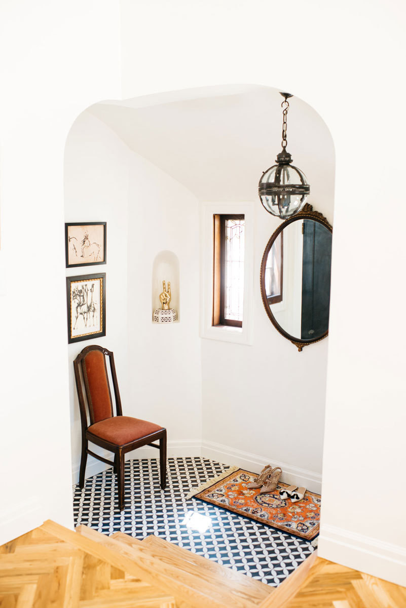 A tiled entryway blends Old-World charm and a modern appreciation for cheeky accents.