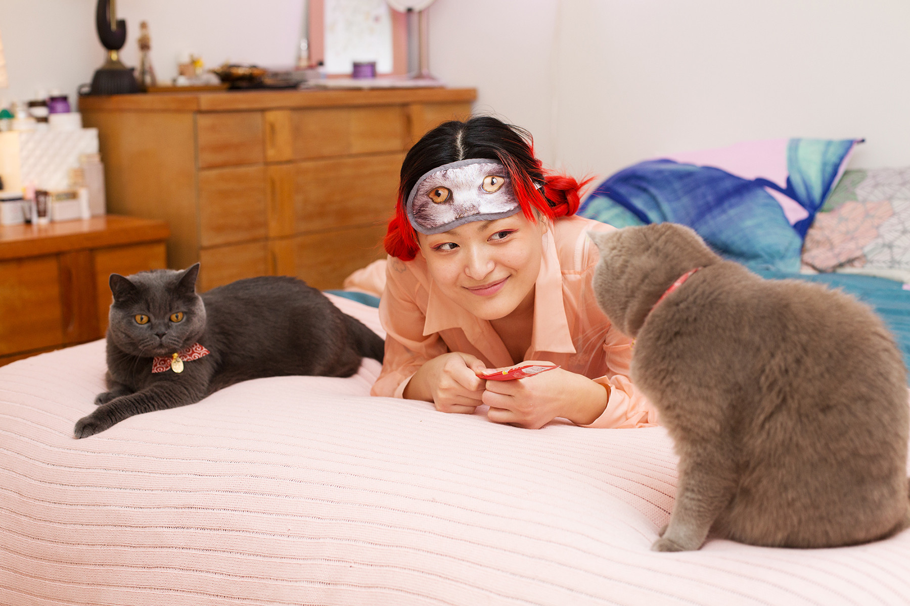Fashion and graphic designerRenee Chen lounges at home with her cats Arya and Temujin.
