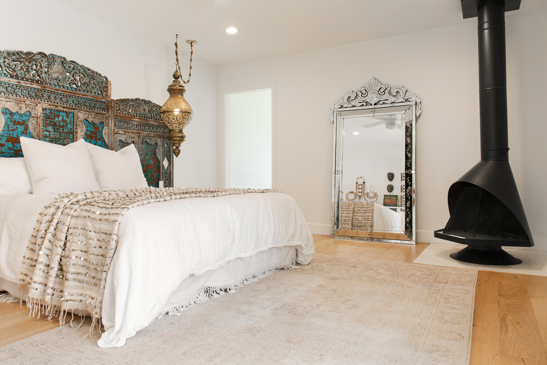With thoughtgul, vintage finds from Bali, Morocco, and Turkey, the main bedroom is a peaceful respite.Dunn-EdwardsPaint | Antique Headboard |Serena & Lily Bedding | Vintage Mirror | Vintage Throw Blanket | Vintage Pendant | Vintage Floor Mirror.