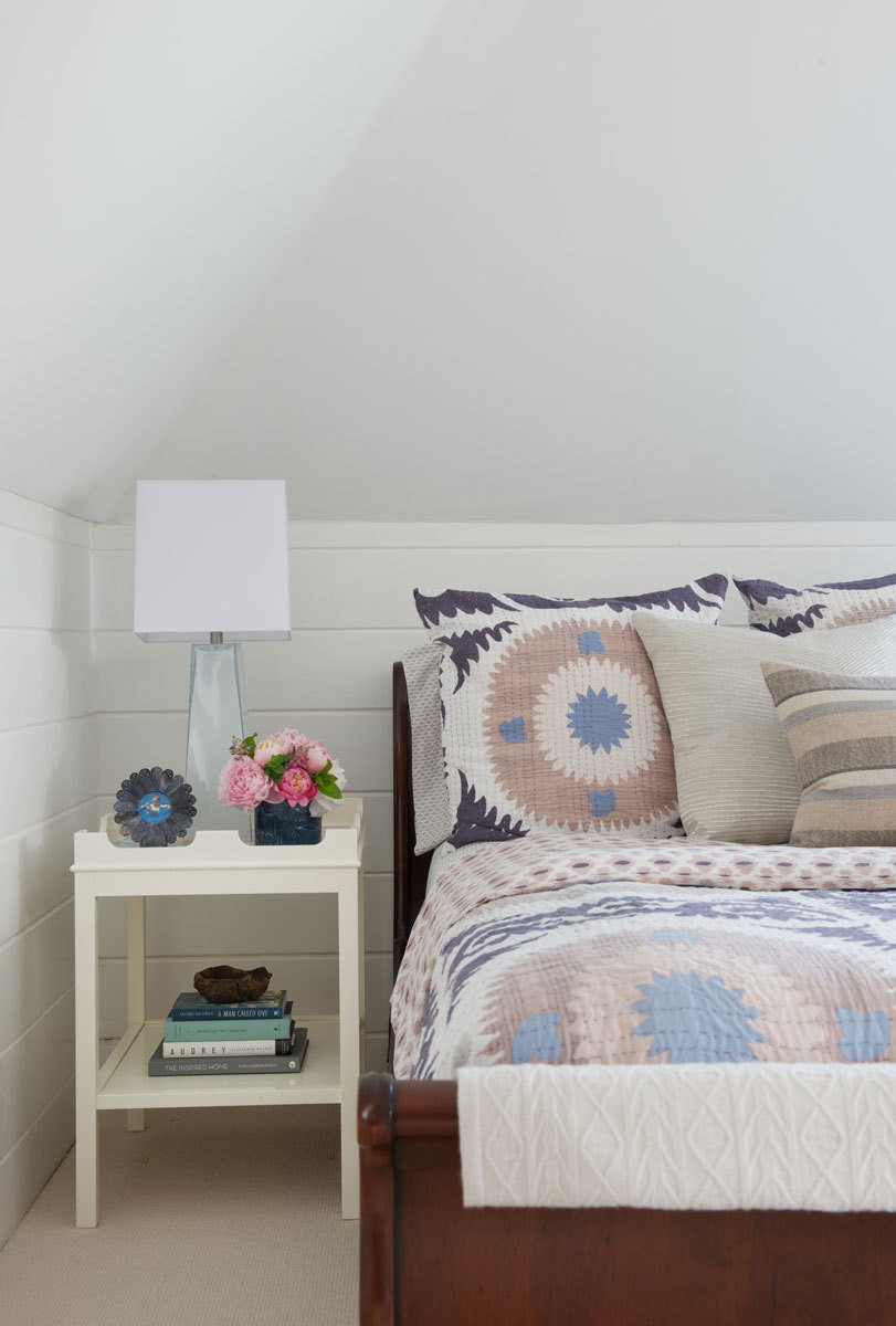 The roofline of the master bedroom has a charming attic feel.