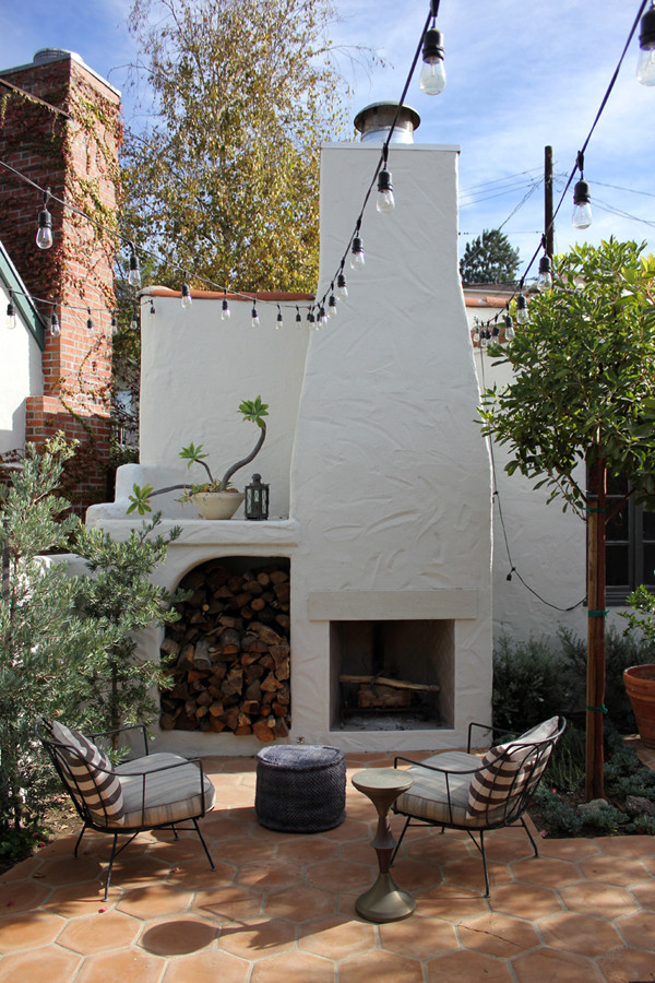 Spanish colonial in los feliz lonny 39 s next big names for Spanish style outdoor fireplace