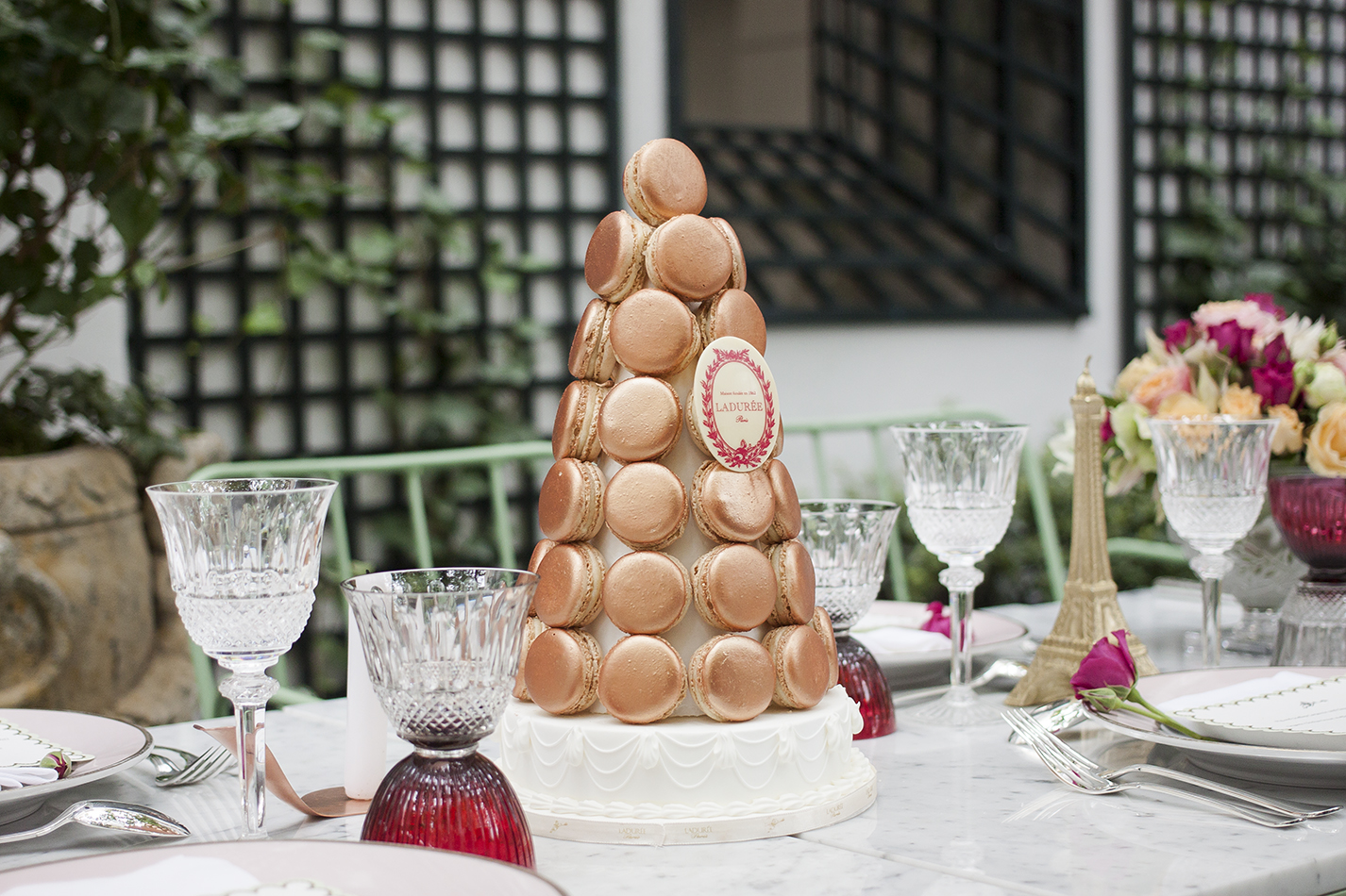 A pyramid made with edible copper macarons takes center stage at Raberin's table.