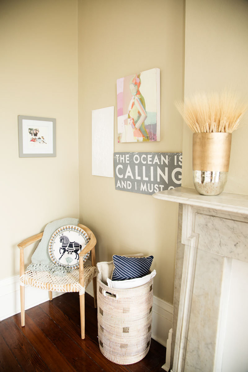 A low-key gallery wall anchors a quiet seating area in Calla'sbedroom.