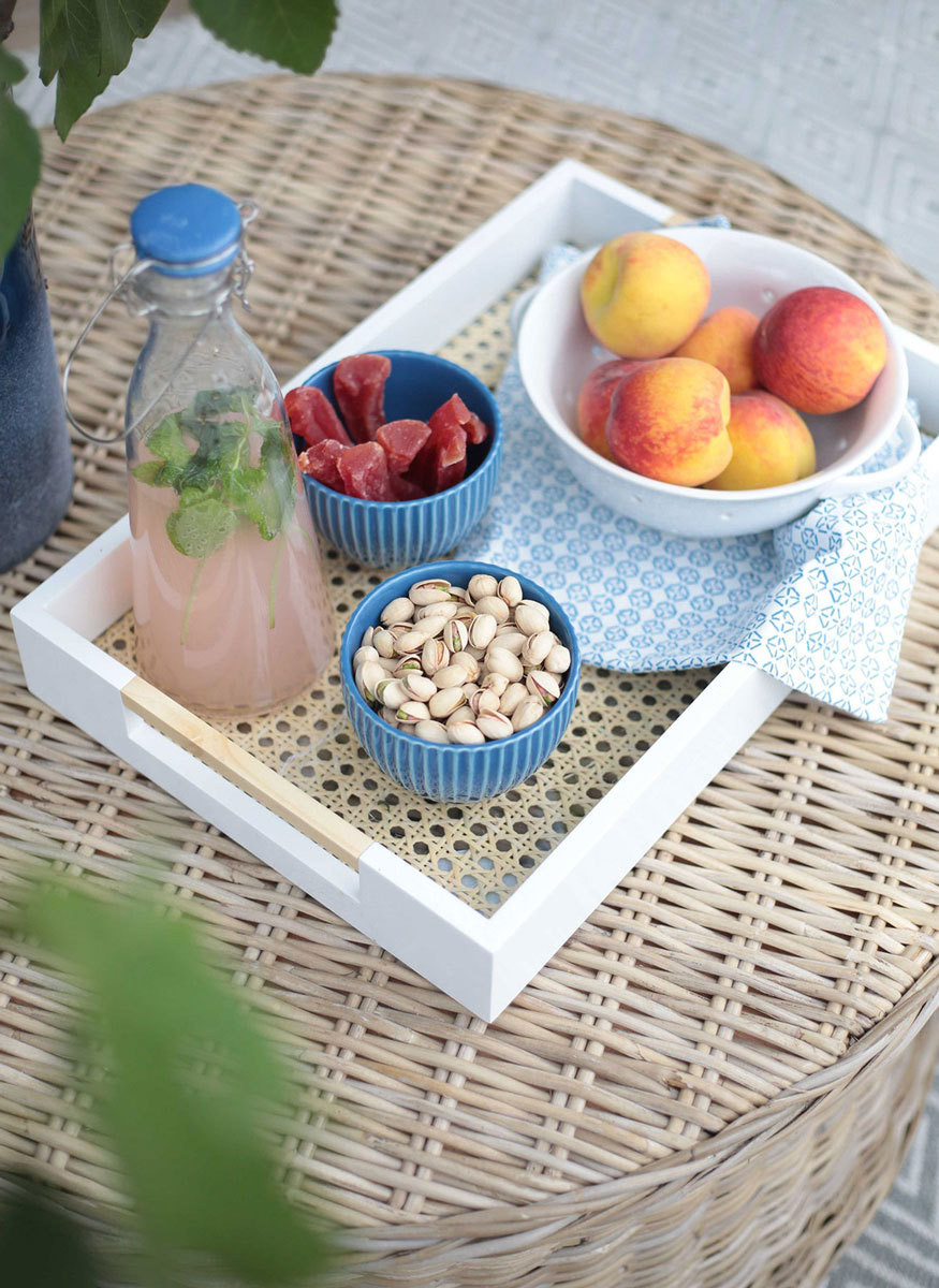 A cane-backed tray is a summer entertaining staple.