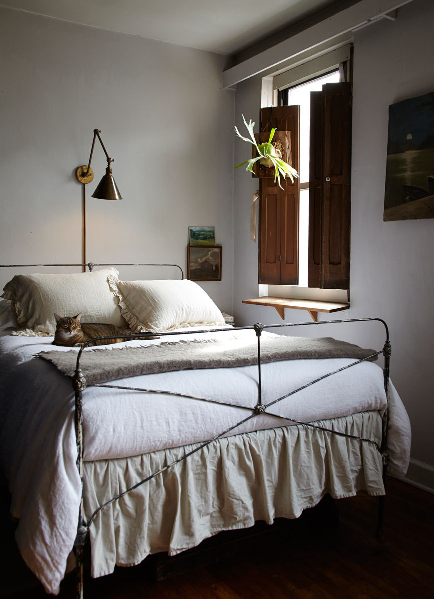A sun-dappled corner of the studio becomes a cozy bedroom.