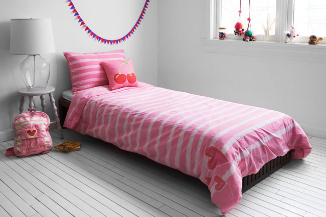 Cherries pillow, $35, and Stripes Duvet, from $40.