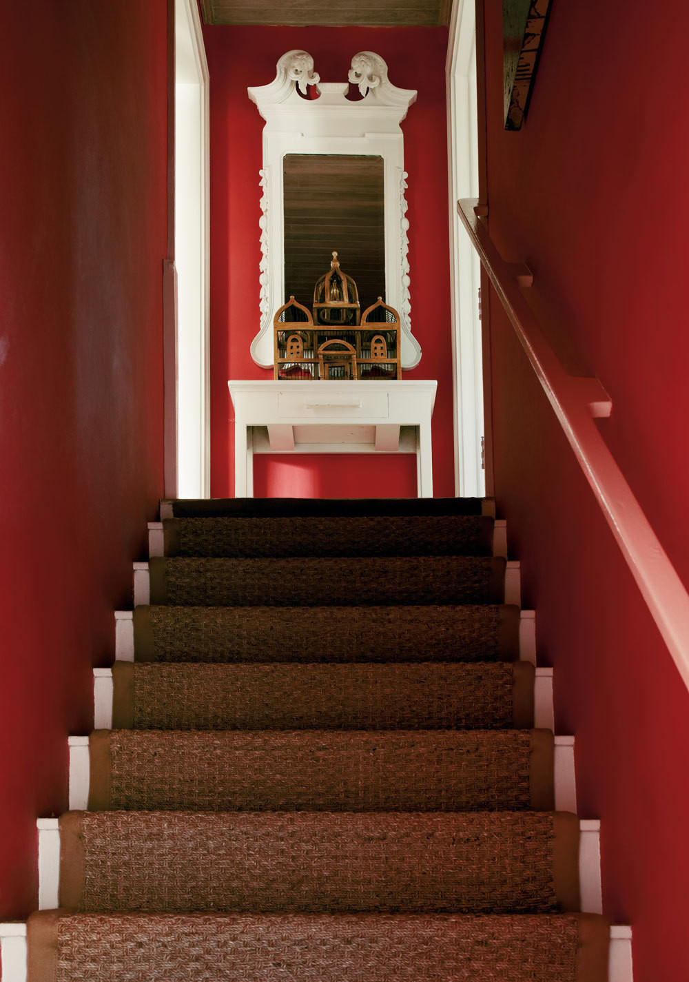 A staircase gets a bold coat of watermelon pink.
