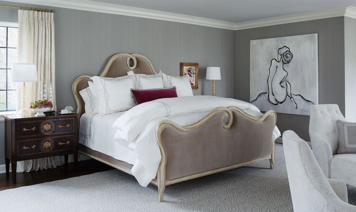 The curvacious velvet-upholstered bed from Ebanista and the oversized figure painting are just two of the glamorous focal points found in the room.