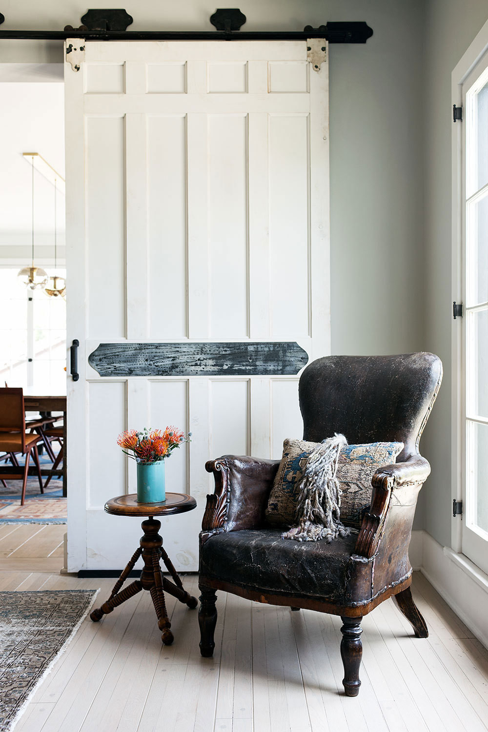 A 19th-century leather chair adds character to the living room.