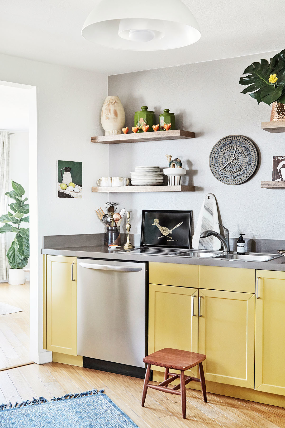 Yellow cabinets and repurposed vintage ceramics create a playful vibe in the dome house kitchen.